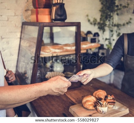 People hands credit card payment bakery