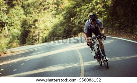Asian men are cycling road bike in the morning #558086152