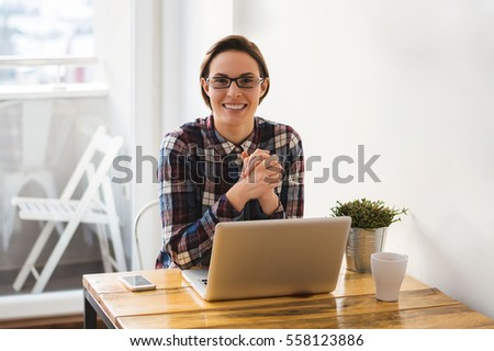 Portrait of beautiful business young woman working from home, smiling. #558123886