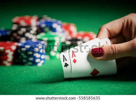 Person showing her deck at the poker game Royalty-Free Stock Photo #558185635