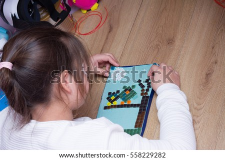 Girl doing applique. from glass stones #558229282