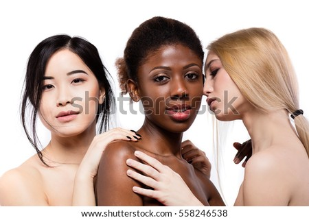 concept of three different ethnicity of women being very close one to each other and looking naked and expressing friendship on white background #558246538
