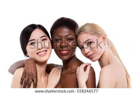 concept of three different ethnicity of women being very close one to each other and looking naked and expressing friendship on white background #558246577