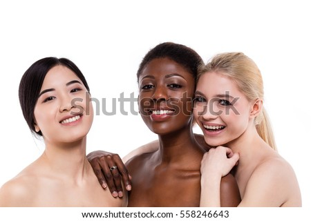 concept of three different ethnicity of women being very close one to each other and looking naked and expressing friendship on white background #558246643