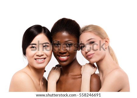 concept of three different ethnicity of women being very close one to each other and looking naked and expressing friendship on white background #558246691