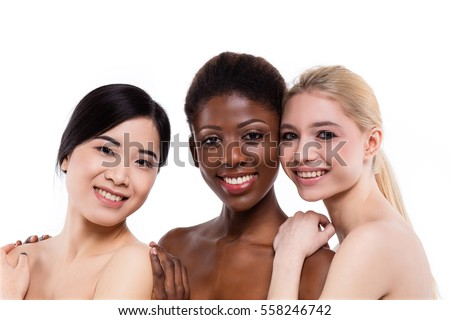 concept of three different ethnicity of women being very close one to each other and looking naked and expressing friendship on white background #558246742