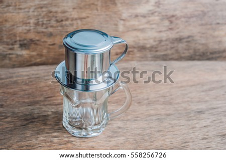 'Phin' traditional Vietnamese coffee maker, place on the top of glass, add ground coffee then pour hot water and wait until the coffee dripping into the glass. #558256726