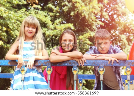Portrait of childrens on the playground #558361699