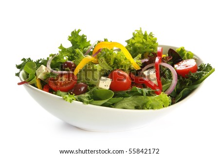 Greek salad in a stylish white bowl.  Isolated on white. #55842172