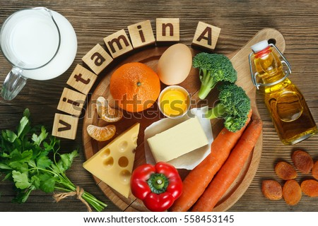 """Vitamin A in food"" Natural products rich in vitamin A as tangerine, red pepper, parsley leaves, dried apricots, carrots, broccoli, butter, yellow cheese, milk, egg yolk and cod liver oil.  #558453145"