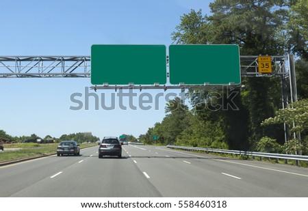 Blank signs spanning interstate lanes. Horizontal.