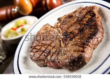 T-bone Steak on plate #558550018