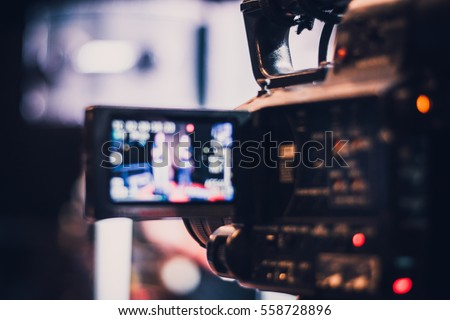 Blur of camcorder while filming. Royalty-Free Stock Photo #558728896