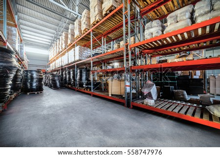 Warehouse industrial goods. Large long racks. Cardboard boxes and coiled plastic tube. Toning the image. #558747976