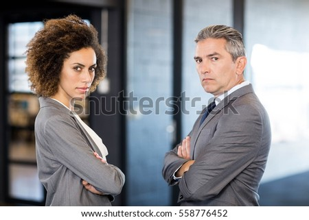 Portrait of businessman and businesswoman with arms crossed #558776452