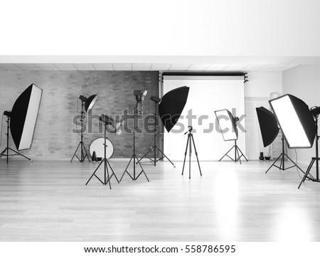 Empty photo studio with lighting equipment #558786595