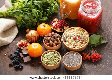 Still life super food - smoothies, muesli, nuts, berries, chia seeds #558876784