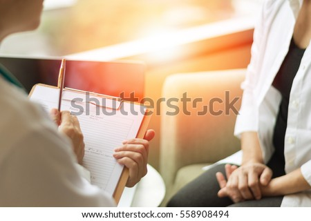 Healthcare concept of professional psychologist doctor consult in psychotherapy session or counsel diagnosis health. Major depressive disorder patient (MDD) with physician. Royalty-Free Stock Photo #558908494