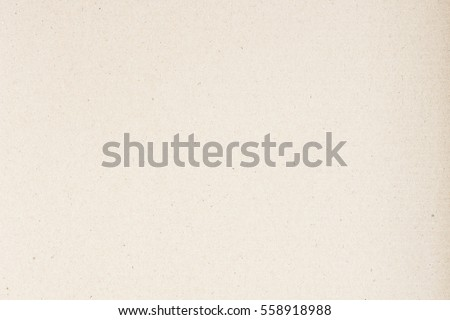 Paper texture light rough textured spotted blank copy space background in beige yellow