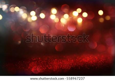Red and black glitter vintage lights background. defocused #558967237