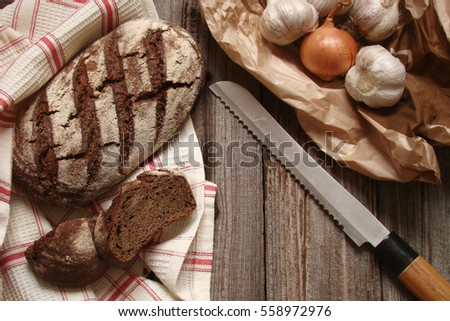 loaf of bread on a towel on the wooden panels in rustic style #558972976