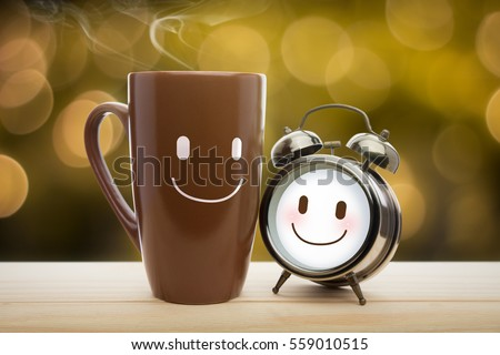 Brown mug, Alarm clock of coffee with a happy smile, Good night or Have a happy day concept