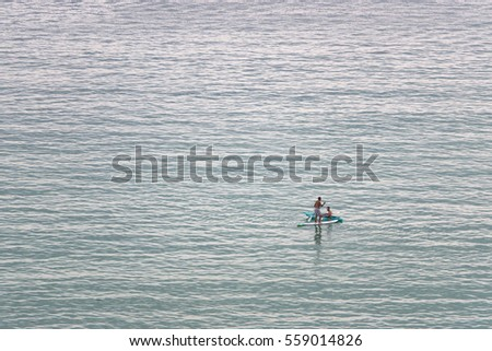 People play paddle boarding on the sea #559014826