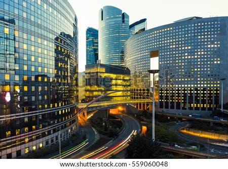 Night architecture - skyscrapers with glass facade. Modern buildings in Paris business district. Evening dynamic traffic on a street. Concept of economics, financial.  Copy space for text. Toned #559060048