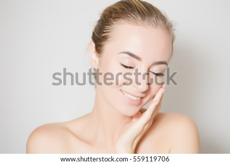 Closeup of female adult with  marks on skin for cosmetic medical procedures #559119706