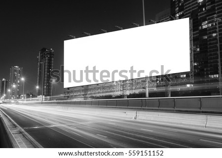 black and white tone of blank billboard on light trails, street and urban in the night - can advertisement for display or montage product or business. #559151152