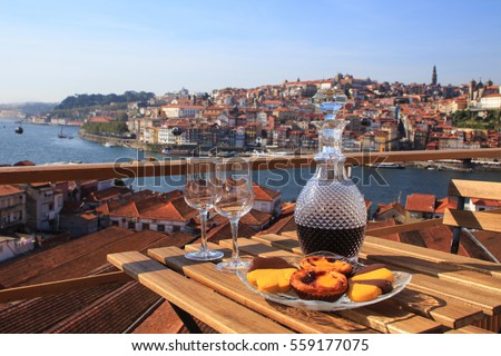 Table with view a wonderful view over the river in Porto, Portugal. Royalty-Free Stock Photo #559177075