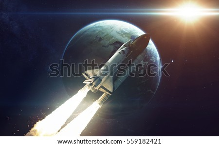 Space shuttle orbiting Earth planet. Elements of this image furnished by NASA #559182421