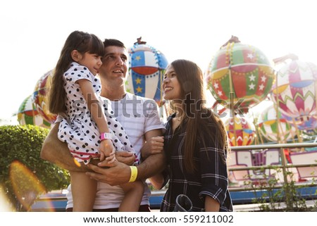 Family Holiday Vacation Amusement Park Togetherness Royalty-Free Stock Photo #559211002