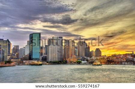 Skyscrapers of the Sydney central business district in the evening - Australia, New South Wales Royalty-Free Stock Photo #559274167