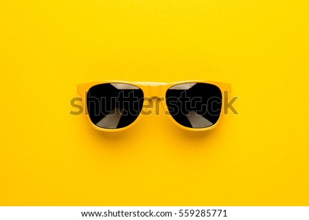 studio shot of yellow sunglasses. summer is coming concept Royalty-Free Stock Photo #559285771
