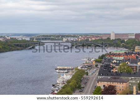 STOCKHOLM, SWEDEN- MAY 21, 2016: Aerial view of central Stockholm with two bridges in background.  #559292614