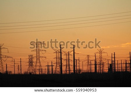 Power lines at sunset #559340953