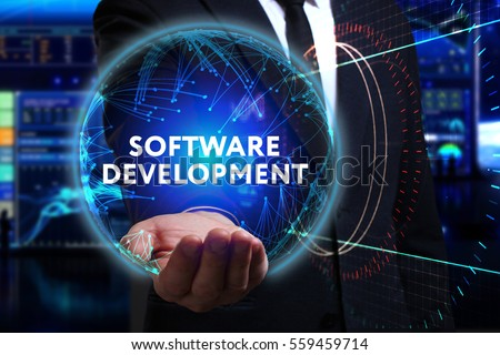 Business, Technology, Internet and network concept. Young businessman working in the field of the future, he sees the inscription: software development  #559459714