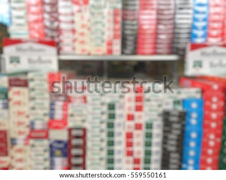 Blur many cigarettes on the shelves for sale. Royalty-Free Stock Photo #559550161