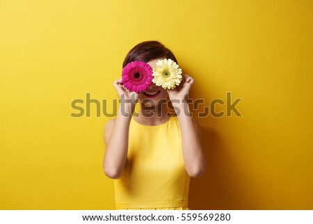 Playful brunette covering her eyes 