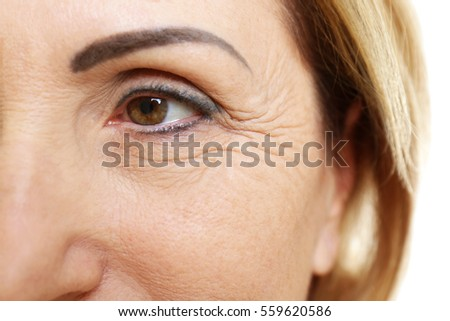 Senior woman face, closeup Royalty-Free Stock Photo #559620586