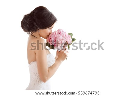 Beautiful bride perfect style. Wedding hairstyle make-up luxury wedding dress and bride's bouquet. Young attractive multi-racial Asian Caucasian model like a bride isolated on white background smells Royalty-Free Stock Photo #559674793
