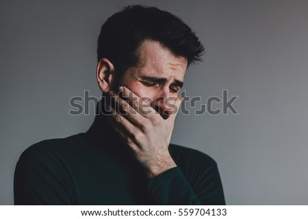 Young man with a problem crying #559704133