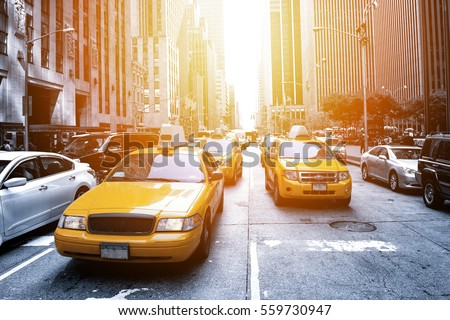 Yellow taxi in a Black and White New York in the sunset
