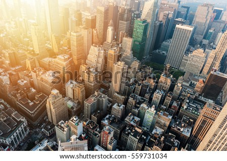 New York City skyline with urban skyscrapers at sunset. Royalty-Free Stock Photo #559731034