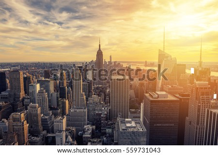 New York City skyline with urban skyscrapers at sunset. #559731043