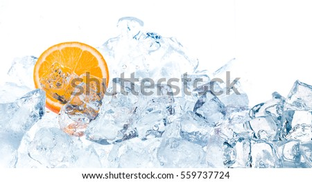 Fresh orange in ice cubes background. #559737724