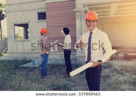 architect and engineer inspect housing estate building to success construction plan before send quality housing to customers ;Showing thumb up for good teamwork   #559800463
