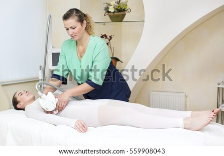 Woman is in the process at the clinic massage #559908043