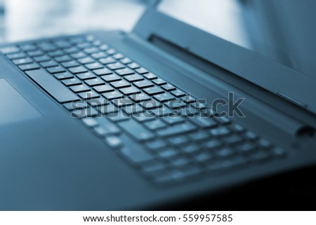 Angled photo of black laptop keyboard, with lights #559957585